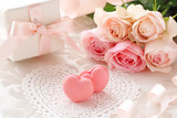 Heart shaped macaroons with Bouquet of pink roses and gift on the table - Fine Art prints