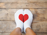 feet wearing white socks with red heart shape - 132291032