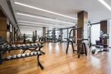 Fototapety Modern gym interior with equipment.fitness center interior