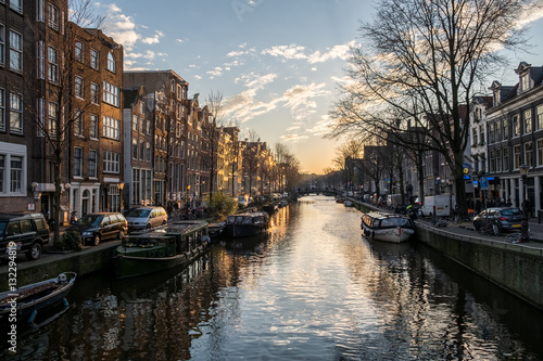 Poster Beautiful sunset over Amsterdam, The Netherlands, with water canals and crazy ar