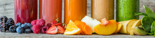 Foto Murales Selection of colourful smoothies on rustic wood background