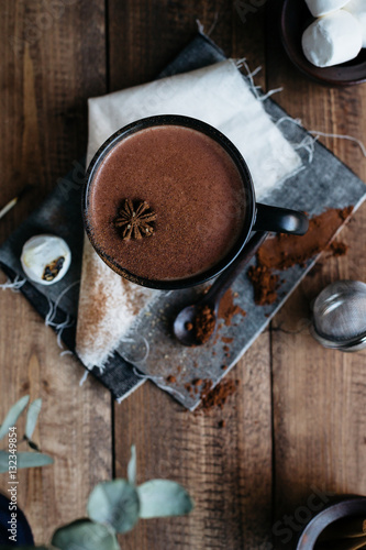 Foto op Canvas Chocolade Overhead View of Hot Chocolate topped with Cinnamon and Star Anise on Rustic Wooden Table