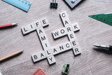 Words work life balance and family on table collected with wooden elements