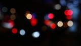 City road traffic lights blured in bokeh circls in night town