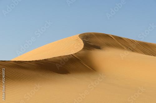 Deurstickers Abu Dhabi Middle East desert – dune ridge in the Liwa Desert, which is part of the Rub al Khali Desert or Empty Quarter desert, straddling UAE, Oman, Yemen and Saudi Arabia