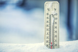 Fototapety Thermometer on snow shows low temperatures under zero. Low temperatures in degrees Celsius and fahrenheit. Cold winter weather twenty under zero.