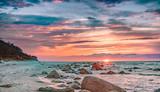 Sonnenuntergang im Meer der Ostsee bei Dranske auf Rügen - 132429696