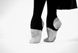 black and white photo of ballet dancer feet on a white background