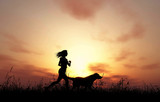 3D female and dog jogging at sunset