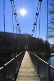 Fototapeta Fototapety mosty linowy / wiszący - Most wiszący na tle słonecznego nieba © bnorbert3