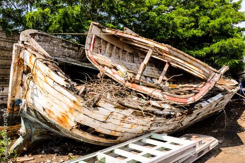 Poster Old and broken wooden boat stranded