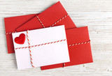 Envelope Mail with Red Heart and Ribbon over White Wooden Background. Valentine Day Card