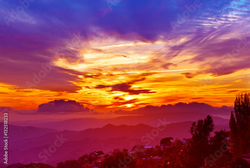 Poster Oranje eclat Amazing mountain landscape with colorful vivid sunset on the bright sky, natural outdoor travel background