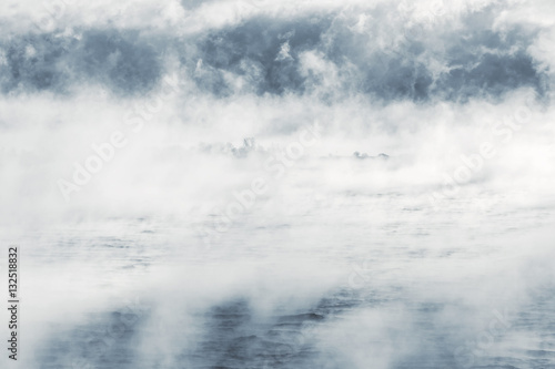Island in a steamy water Poster