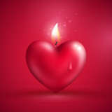Red heart shape candle on pink background