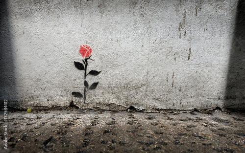 Single rose stencil graffitti on wall in London - 132544412