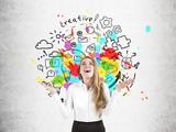 Happy businesswoman near a round idea sketch
