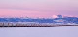 Freight Train leading to Longs Peak during a winter sunrise pano