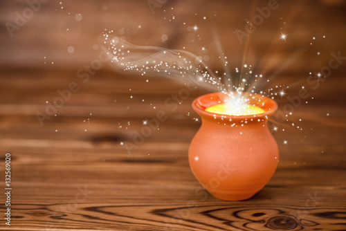 Poster concept greeting card of clay pot with mystical miracle light on