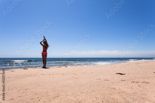 Poster Beautiful Girl White Hair and red swimmingsuit staying on beach, relaxing and enjoy freedom
