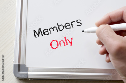 Members only written on whiteboard Photo by eenevski