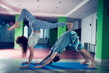 young man and woman doing acro yoga  indoor