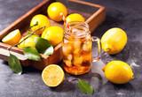 glass jar of iced tea with fresh lemons