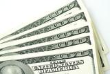 One hundred dollar bills against white background.