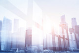 futuristic business background, double exposure of office window and city skyline - 132614038