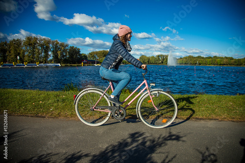 Poster Girl biking in city
