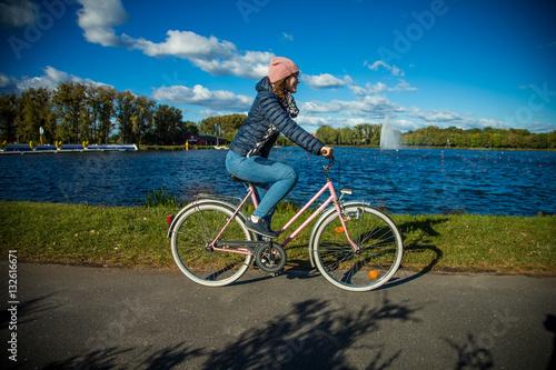 Poster Girl biking in city