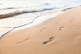 footprints of couple on the sand of beach - 132618865