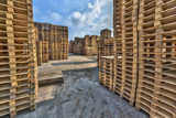 Business area with large stacks of euro cargo pallets