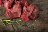 Raw beef with rosemary and salt