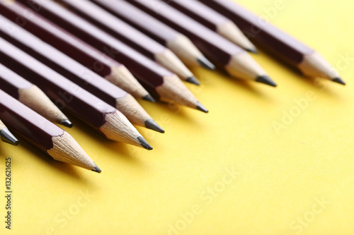Poster Drawing brown pencils on a yellow background