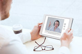 e-learning, video conference, coaching online, man looking at the screen of tablet - 132621801