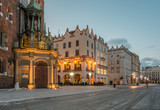 Krakow, Poland, St Mary's church and houses on Main Market square in the morning