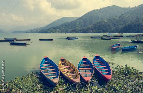 Poster Colorful boats at shore.