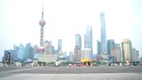 Runner running in city of Shanghai, China on famous boardwalk with skyline. Urban city lifestyle. Active Asian woman training outside jogging on the Bund.