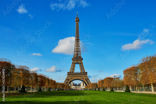Eiffel tower over blue sky. Sunny autumn day in Paris