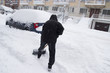Shovelling Snow in a Winter Snow Storm in Montreal Quebec Canada North