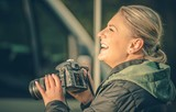 Happy Female Photographer - 132648681