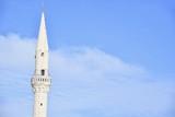 Isolated White Minaret Against the Blue Sky