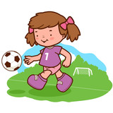 Little girl soccer player kicking a ball on the playing field