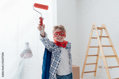Fotografiet Superhero doing home renovation