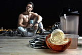 Protein shake Vanilla flavor accompanied by weights and sportsme - 132678832