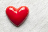 Red heart on scratched surface background