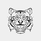 Hand-drawn pencil graphics, tiger head. Engraving, stencil style.