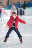 Happy boy with red hat, skating during the day, having fun