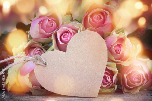 Rose background with a heart